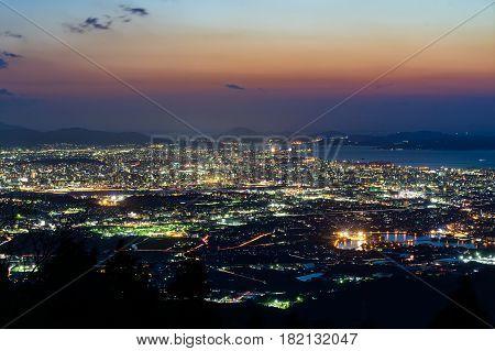 Nightview of Fukuoka City at dusk in Fukuoka, Japan.