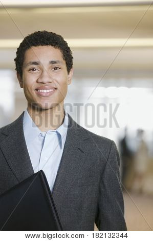 Mixed race businessman smiling