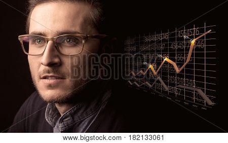 Elegant Businessman with Line Graphs and Statistics
