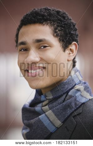Close up of mixed race businessman wearing scarf