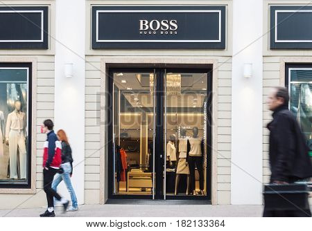 VILNIUS LITHUANIA - MAY 03 2016: View of Hugo Boss luxury fashion house store entrance with brand signage in Vilnius Lithuania