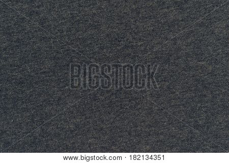 abstract background and texture of jersey or knitted textile fabric of dark color