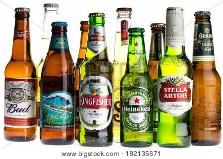 GRONINGEN, NETHERLANDS - APRIL 15, 2017: Collection of Budweiser, Kona, Sol, Stella Artois, Brand, Corona, Jupiler, Heineken, Warsteiner and Kingfisher lager beers isolated on a white background
