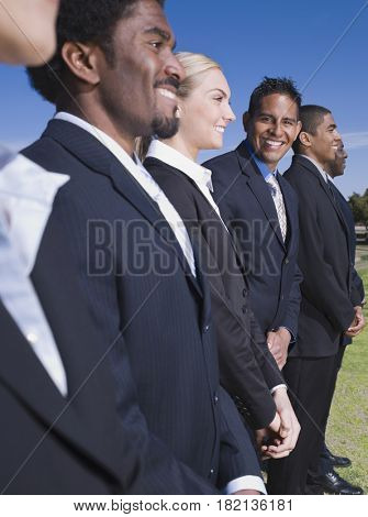 Business people in a row outdoors