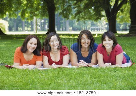 Asian sisters having picnic in park