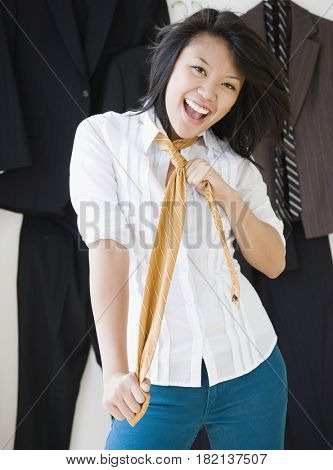 Asian woman wearing men's necktie
