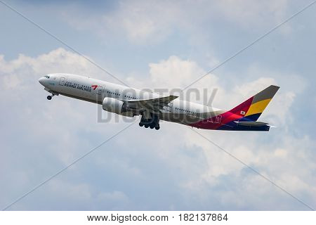 FUKUOKA, JAPAN - APR. 15, 2017: Boeing 777-200 taking off from the Fukuoka International Airport in Fukuoka, Japan.