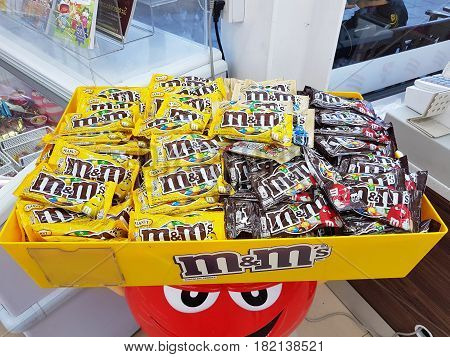 BANGKOK THAILAND - MARCH 31 : M&M's candy on a yellow tray in 7-Eleven on March 31 2017 in Bangkok Thailand.