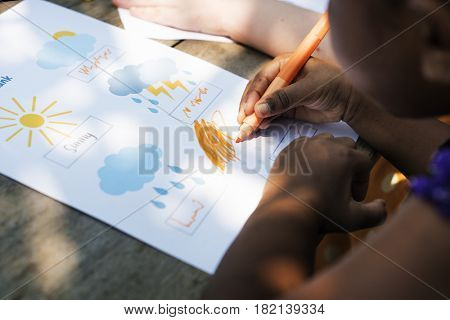 Little girl drawing imagination outdoors