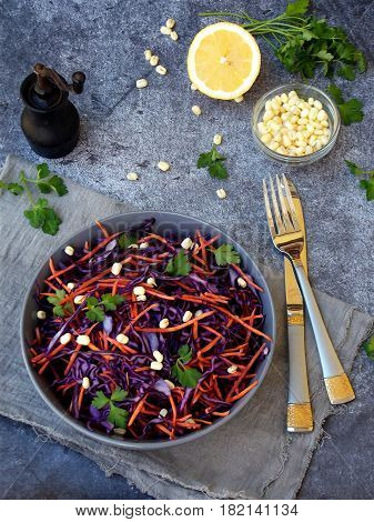 Fresh Vegetables Salad With Purple Cabbage, Carrot, Sprouted Mung, Parsley On Grey Clay Plate On Dar