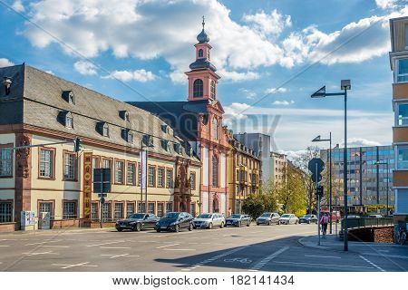 FRANKFURT AM MAIN ,GERMANY - MARCH 30,2017 - Deutschordenskirche church in the streets of Franfurt am Main. Frankfurt is the major financial centre of the European continent.