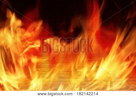 Wooden wall on fire with flames - Fire safety concept.