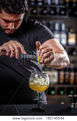 Bartender Muddling Lime