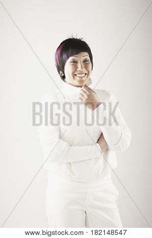 Asian woman in white clothing smiling