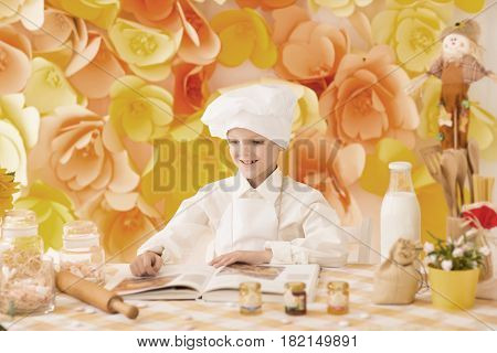 cute little baby is preparing tasty meals the kitchen