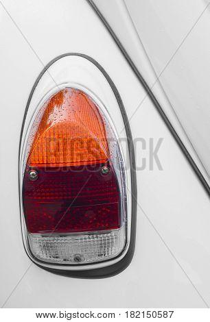 Backlight on a white car closeup .