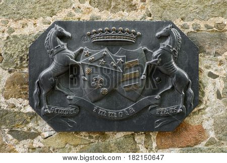 Coat of arms of the Vorontsov family on a wall of the Vorontsovsky Palace Alupka Crimea Ukraine.