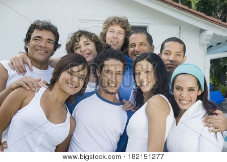 Multi-ethnic friends hugging