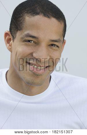 Confident Hispanic man smiling