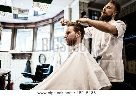 Hair mustache beard treatment in barber shop