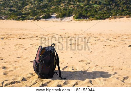 Travel concept - Backpack on Sea Sandy Beach.