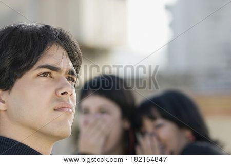 Women laughing at Hispanic man