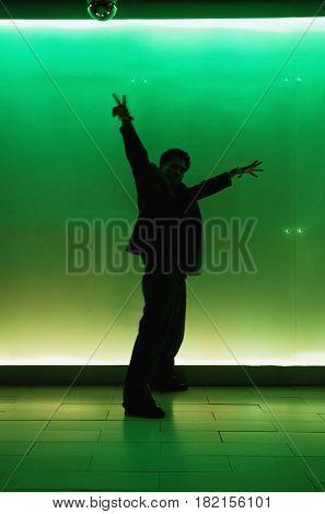Silhouette of man dancing in nightclub