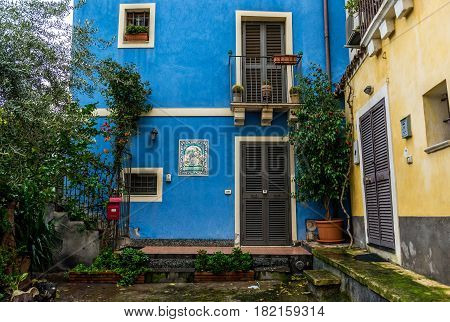 Blue residential building in Catania Sicily Island of Italy