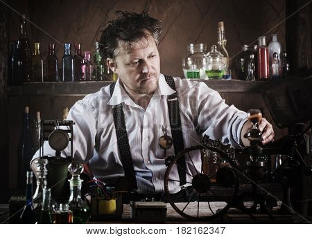 medieval scientist reading book in his laboratory