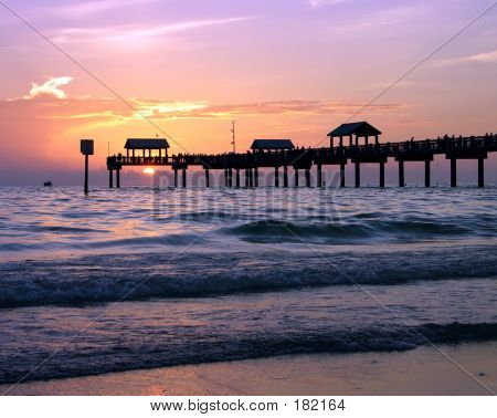 sunset behind clearwater pier on the west coast of florida poster