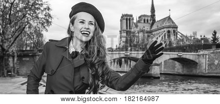 Traveller Woman On Embankment In Paris, France Handwaving