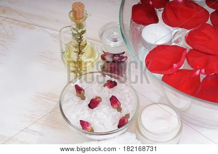 Accessories for manicure: hand bath with rose petals, essentials oils,  bath salt, towels, cream. Beauty and spa concept