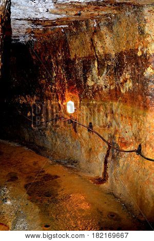 Gold - old roman tunnel in gold mine Rosia Montana, Transylvania, Romania. Rosia Montana is a commune of Alba County in the Apuseni Mountains of western Transylvania, Romania.The rich mineral resources of the area have been exploited since Roman times or