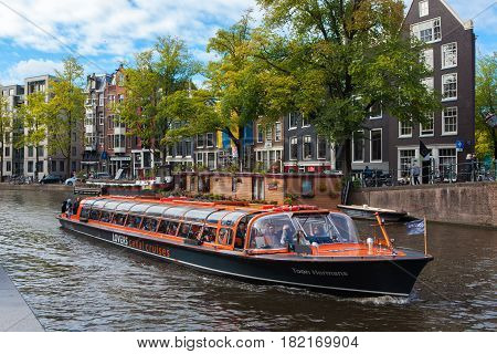 Amsterdam Netherlands - October 3 2016: Tourboat with tourists during a sightseeing tour of the canals of Amsterdam.