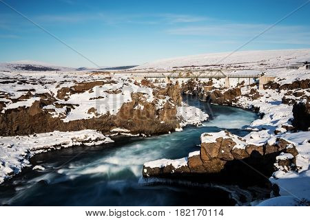 Godafoss waterfall's river in winter , Iceland