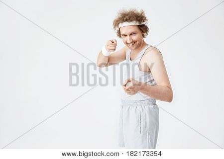 Retro man pointing at camera with pointer fingers. Motivated funny sportsman ready for training hard