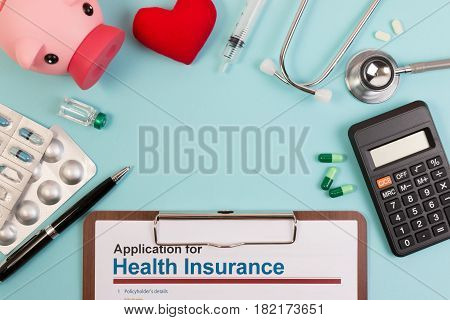 Topview Of Application Form For Health Insurance, Paperwork, Questionnaire, Pen, Tablet, Calculator,