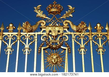 Versailles chateau France. Detailed view of golden gate to palace the Royal residence near Paris.