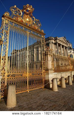 Versailles chateau France. View of golden gate to palace the Royal residence near Paris.