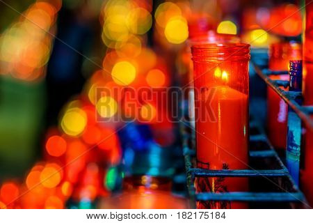 Church candles in transparent chandeliers, monastery of Santa Maria de Montserrat (Montserrat Monastery) in Catalonia, Spain