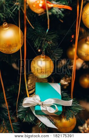New year's gift under the Christmas tree, decorated with balloons
