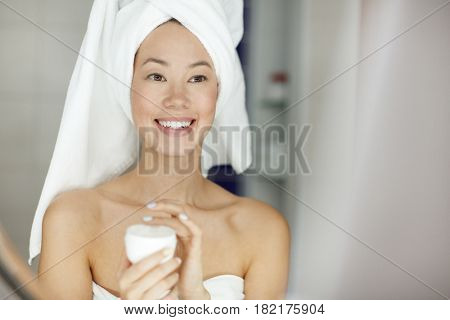 Young woman taking care of her sensitive skin