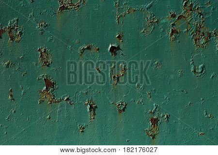 Corroded green metal background. Metal background with rusted spots.
