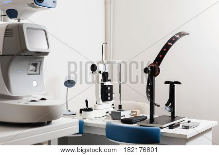 Modern eye testing device standing in the lab. Tonometer in ophthalmologist's office.