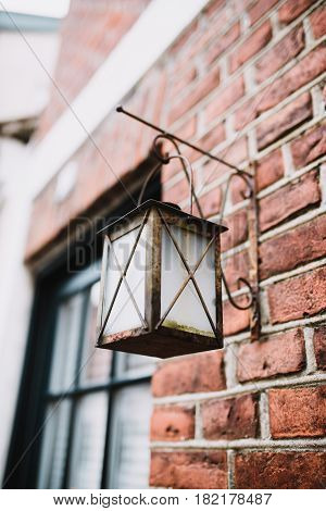 Traditional vintage lamp on a house facade in Ribe Denmark
