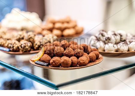 Chocolate truffle candies in confectionery store