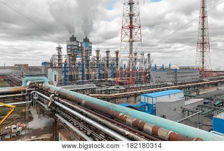 Chemical plant for production of ammonia and nitrogen fertilization on day time. The pipeline connecting the plant's workshops