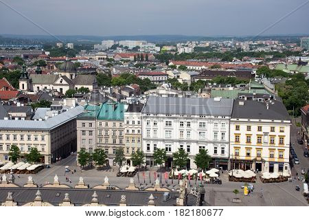 KRAKOW, POLAND - MAY 29, 2016: Aerial view of the northwestern part of the Main Market Square of Krakow the old buildings and the Spiski palace. Poland. View from St Mary's Cathedral.