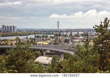 Aerial view of the Kiev city from an observation point over the Dnieper river with railway bridge yachts at the berth and new residential district on the left coast of Dnieper. Kyiv capital of Ukraine