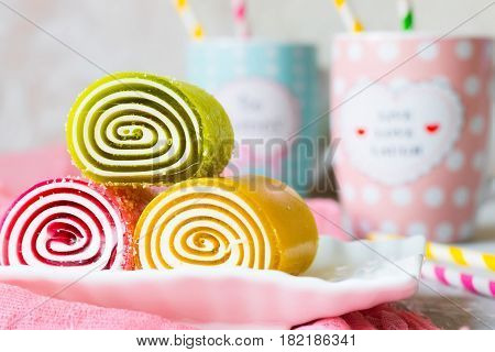 Multicolored fruit marmalade sweets of different forms in sugar